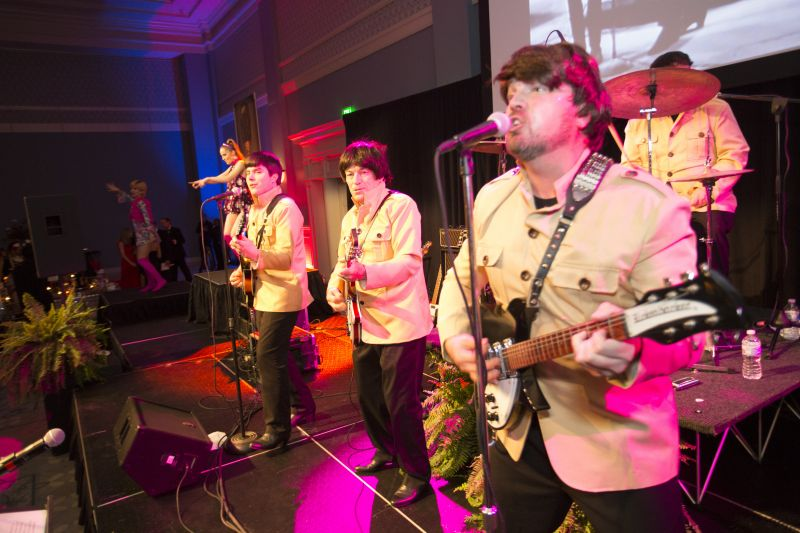 Debonaire Entertainment stole the show as a Beatles cover band.