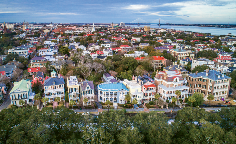 """""""South Battery & King"""" {Altitude: 120 feet}  Flying above the oaks in White Point Garden offers a new vantage point to take in the historical homes on South Battery, with the Holy City skyline and Charleston Harbor in the background."""
