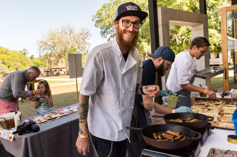 Axel Peyton of Poogan's Smokehouse preparing pork hoagies
