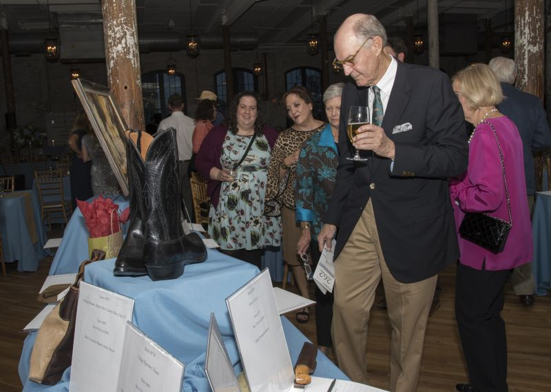 Guests browsed silent auction items.