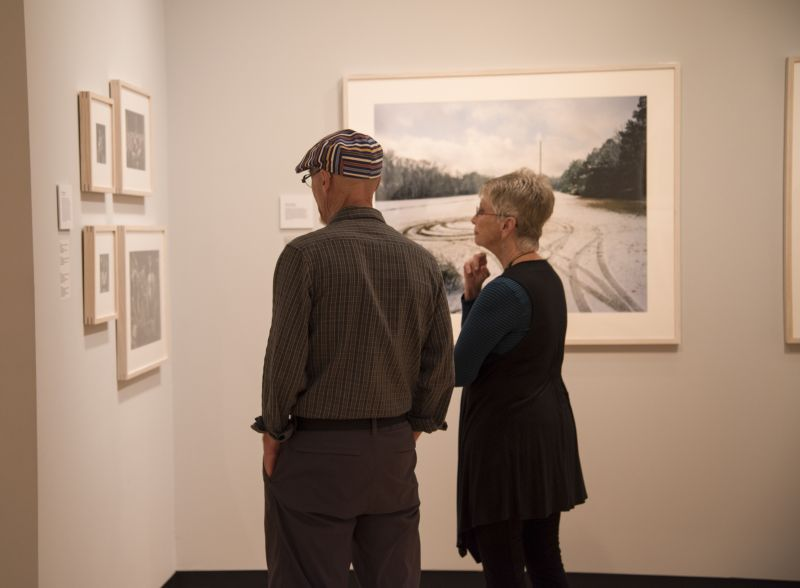 "Attendees take in works in the ""Southbound"" exhibition."