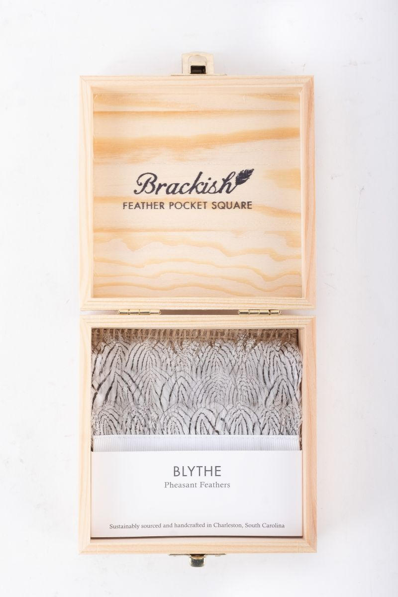 "Brackish ""Blythe"" pheasant pocket square, $85 at Grady Ervin & Co."