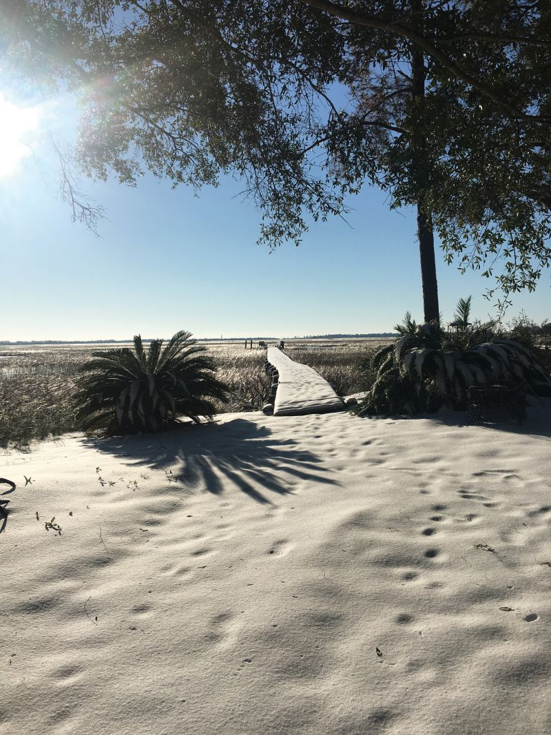 <strong>Clark Sound, James Island:</strong> What at first appears to be a sandy beach is really a snow-covered yard and dock. The cool stuff stuck around for a few rare days of wintry fun; <em>photograph byMelinda Smith Monk</em>