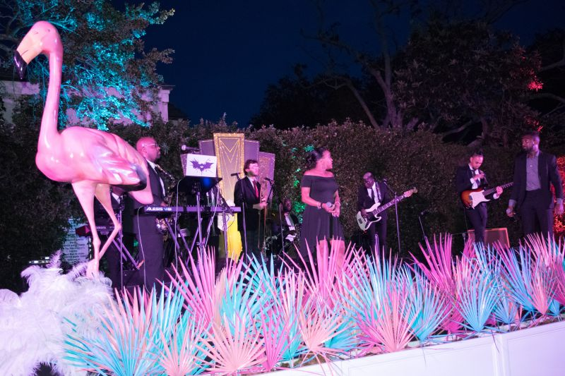 The live music stage was a bright centerpiece for the Miami-inspired theme.
