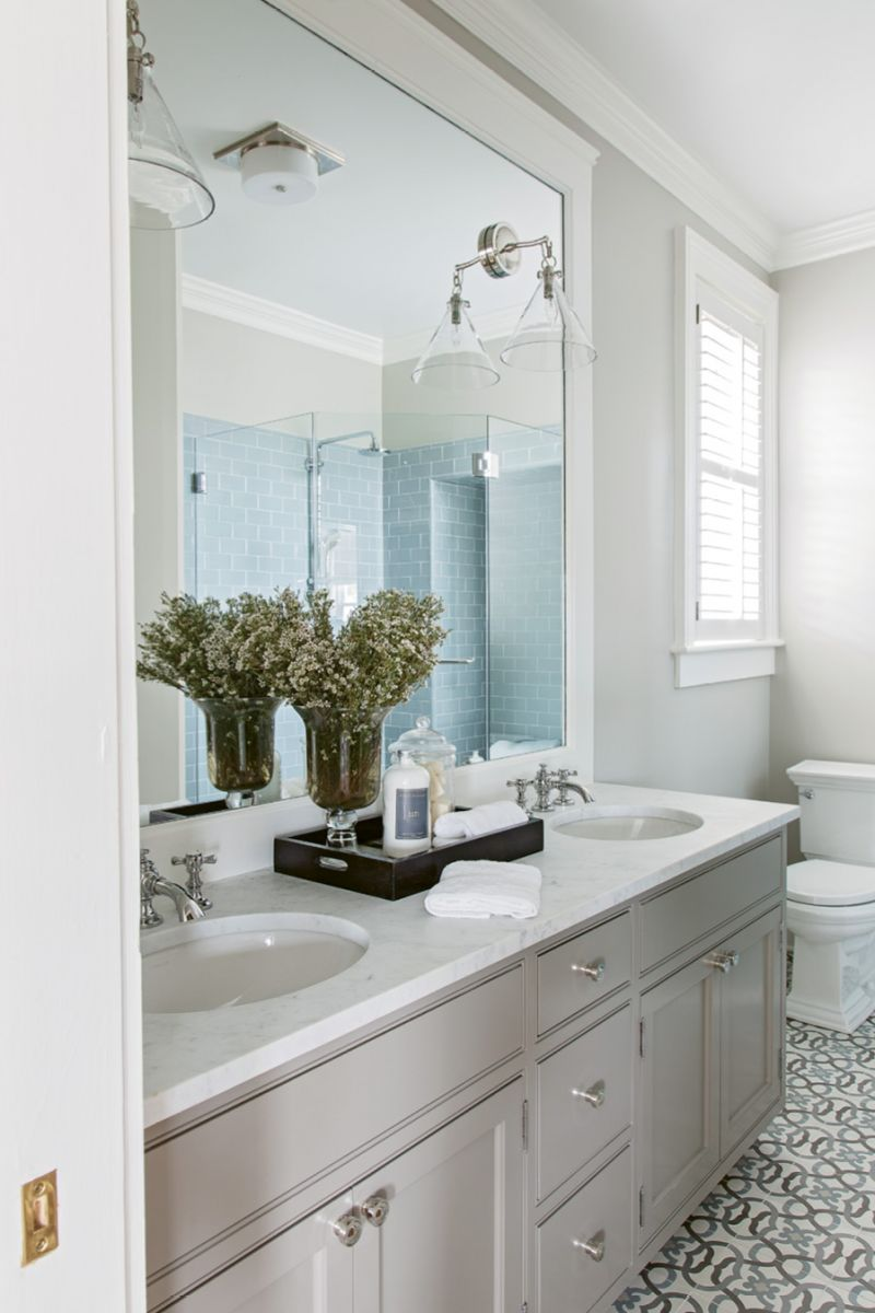 """Floored: """"I loved the simplicity of the pattern,"""" says Peake of the cement tiles that set the tone for the master bath. Tiling the bathrooms was the only instance where the original floors were altered."""