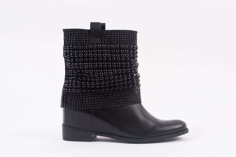 "Schutz ""Annik"" boot, $320 at Shoes on King"