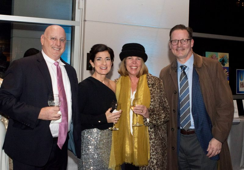 Peter and Anna Stonefield, Suzy Pfeifer, and Aquarium CEO Kevin Mills
