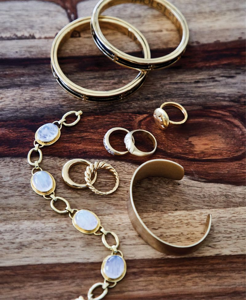 """FOUND TREASURES - (Top to bottom) Holst + Lee signature bangle in """"black,"""" $90 each at Out of Hand; Gurhan """"Starlight"""" gold and diamond ring, $2,950 at Gwynn's of Mount Pleasant; Anthony Lent 18K gold and diamond ring, price upon request at RTW; 18K gold and round brilliant-cut diamond ring, $2,397 at Sandler's Diamonds & Time; David Yurman 18K gold """"Pure Form"""" stack rings, $1,900 at REEDS Jewelers; Kendra Scott 14K gold-plate """"Tenley cuff,"""" $95 at Kendra Scott; Mazza Company 14K gold and moonstone bracelet, $4,600 at Croghan's Jewel Box"""