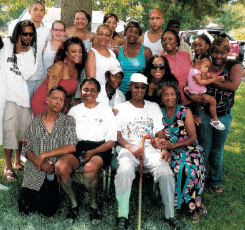Her 79th birthday with her older brother (seated, front row) and her family
