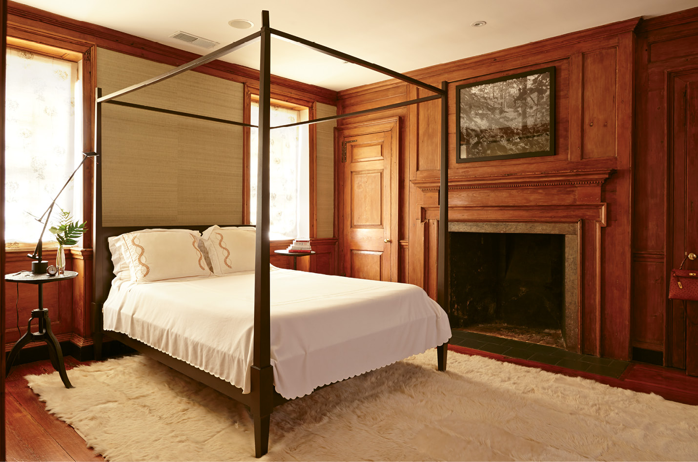Original cypress paneling lends a dignified air to the master bedroom.